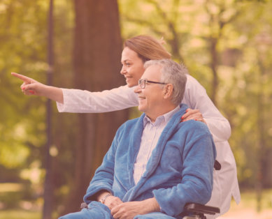 senior male and caregiver sightseeing