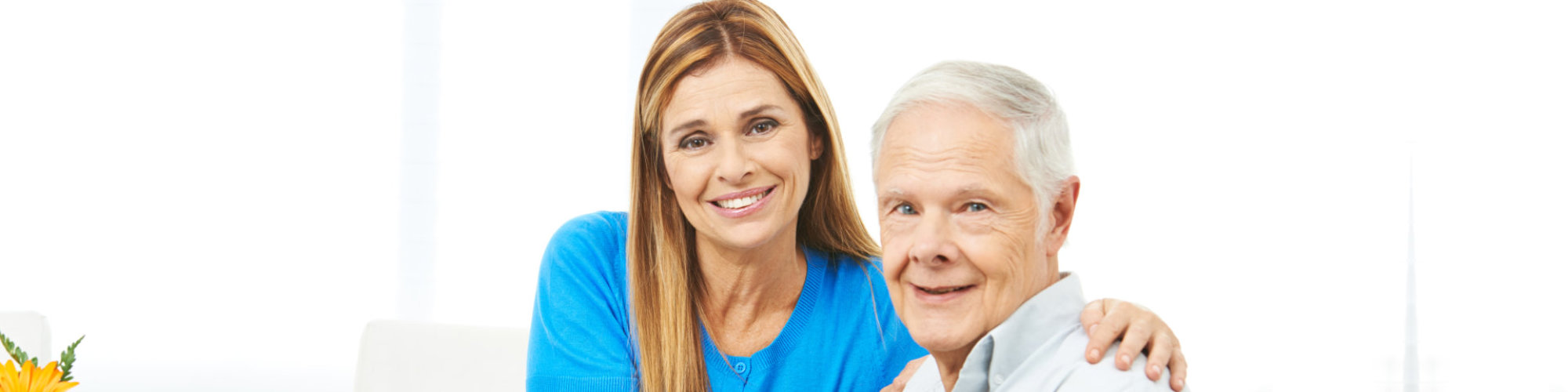 caregiver with senior smiling